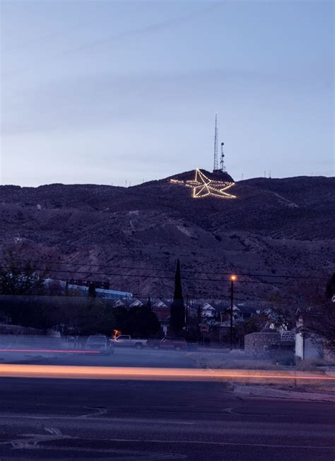 A large, illuminated star, high above El Paso, Texas, on